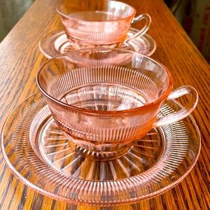 Vintage two sets of pink glass teacups and saucers